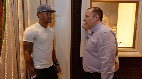 Rose and Thibs discussing in hallway before first Team USA practice (Photo: USA Basketball)