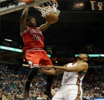 Jimmy Butler throws down a dunk against the Bucks during the 2014-2015 season