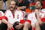 Joakim Noah and Pau Gasol watching from the bench